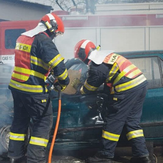 Firefighters Breaking Through Broken Vehicle