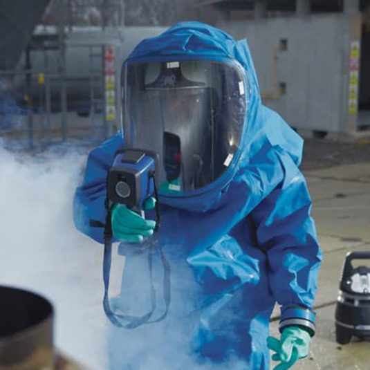 Worker Wearing Dräger HPS 7000 Inside Hazmat Suit