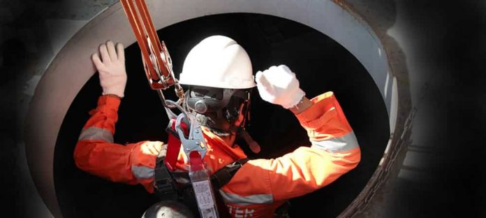 Workman entering a Confined space